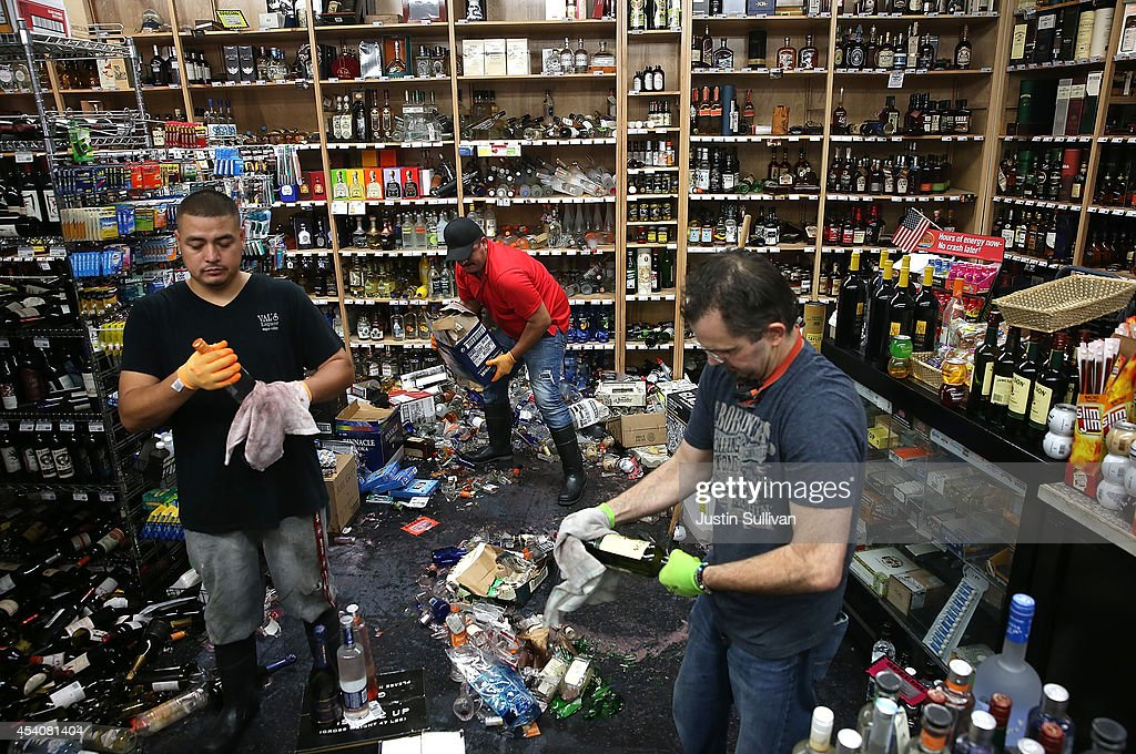 Workers clean up piles of bottles that were thrown from the shelves at Van's Liquors following a reported 6.0 earthquake on August 24, 2014 in Napa, California. A 6.0 earthquake rocked the San Francisco Bay Area shortly after 3:00 am on Sunday morning causing damage to buildings and sending at least 70 people to a hospital with non-life threatening injuries.