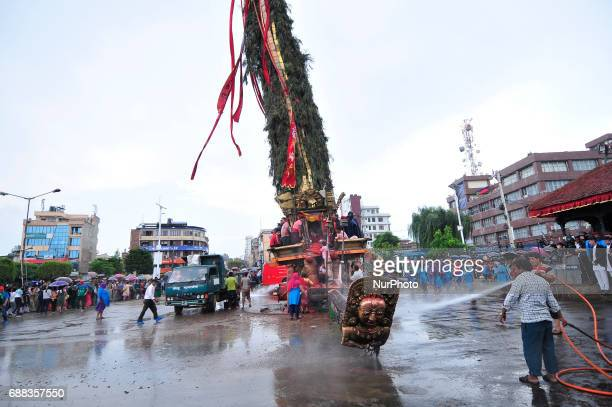Workers cleans around the Rato Macchendranath Chariot as for the celebration of Bhoto Jatra festival at Jawalakhel Patan Nepal on Thursday May 25...