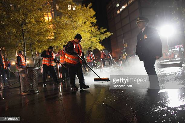 Workers cleanup Zuccotti Park after New York City police in riot gear removed Occupy Wall Street protesters early on November 15 2011 in New York...