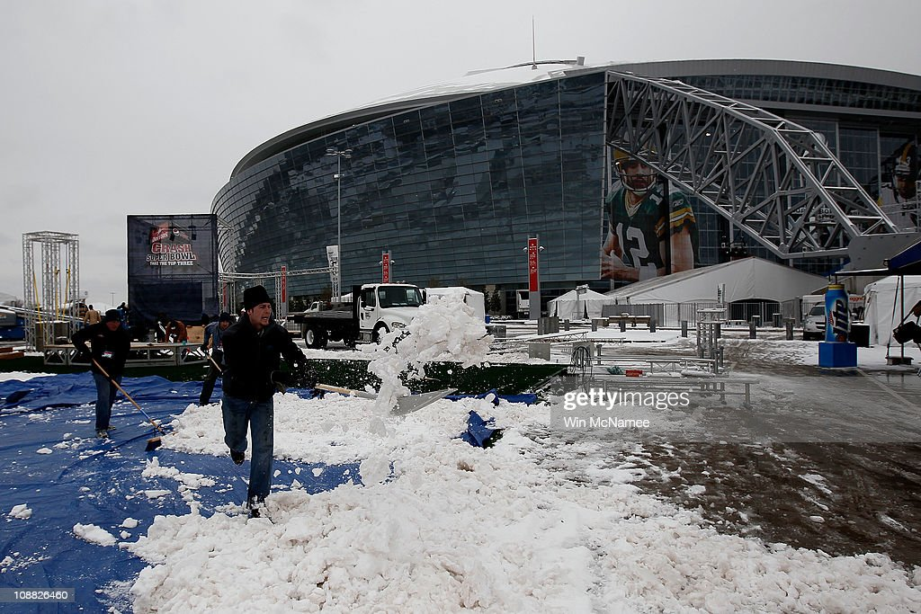 Workers clear snow outside the perimeter of Cowboys Stadium after a snowstorm hit the area February 4 2011 in Dallas Texas More than four inches of...