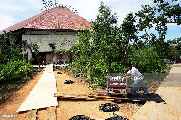 Workers clear the Gran Tlachco Theater after the cancellation of the MTV Latin Video Music Awards October 19 2005 in Xcaret Mexico Hurricane Wilma...