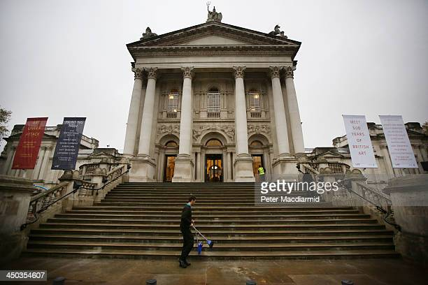 Workers clear the steps at Tate Britain on November 18 2013 in London England Architects Peter St John and Adam Caruso have revitalised The Tates...