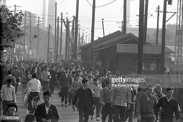 Workers commute near Tsurumi station in October 1950 in Kawasaki Kanagawa Japan