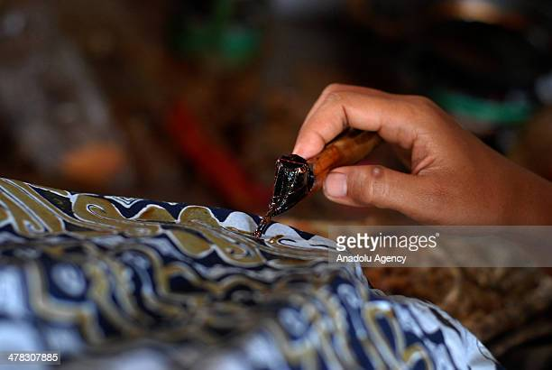 Workers completed batik cloth using natural dyes extracted from various parts of plants such as roots wood leaves seeds or flowers on March 12 2014...