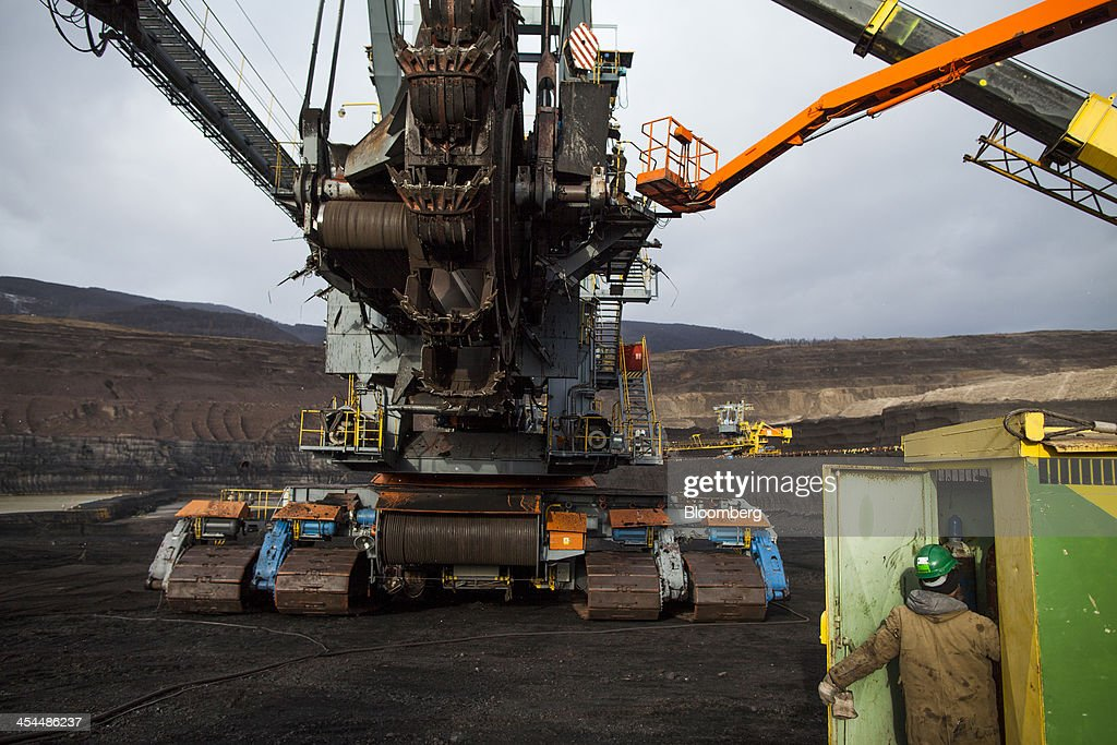 Workers conduct maintenance on a giant excavation machine used to collect lignite, also known as brown coal, in the open pit mine operated by Czech Coal AS near the town of Horni Jiretin, Czech Republic, on Friday, Dec. 6, 2013. The government may set up a joint company with Severni Energeticka that will seek lifting current environmental limits on lignite mining, Lidove Noviny reports, citing proposal submitted by Industry and Trade Ministry. Photographer: Bartek Sadowski/Bloomberg via Getty Images