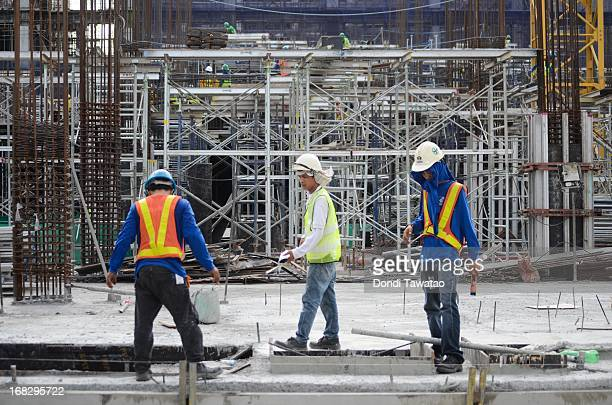 Workers construct a building in the financial district of Makati on May 8 2013 in Manila PhilippinesThe Philippines is in the throes of a property...