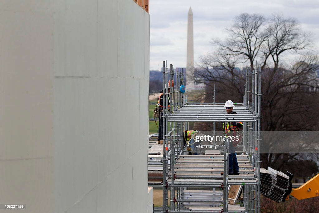 Workers construct scaffolding on the platform being built on the west front of the U.S. Capitol in preparation for the inauguration ceremony of U.S. President Barack Obama in Washington, D.C., U.S., on Tuesday, Dec. 11, 2012. The presidential inauguration ceremony will take place on Jan. 21, 2013. Photographer: Andrew Harrer/Bloomberg via Getty Images