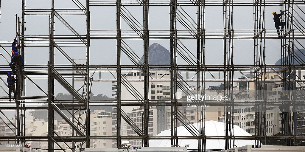 Workers construct the FIFA Fan Fest stage, where fans will be able to watch games broadcast live, on Copacabana Beach on June 1, 2014 in Rio de Janeiro, Brazil. Brazil has won five World Cups, more than any other nation. The 2014 FIFA World Cup kicks off June 12 in Brazil.