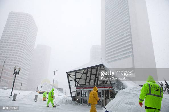 Workers continue clearing snow around the Massachusetts Bay Transportation Authority's South Station on February 9 in Boston Massachusetts Boston was...