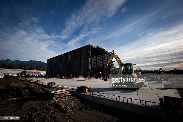 Workers continue construction on a building to be used for ship manufacturing at the Seaspan Vancouver Shipyard in North Vancouver British Columbia...