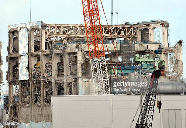 Workers continue debris removal work on the fifth floor of fourth reactor building at Fukushima Daiichi Nuclear Power Plant during the press tour on...