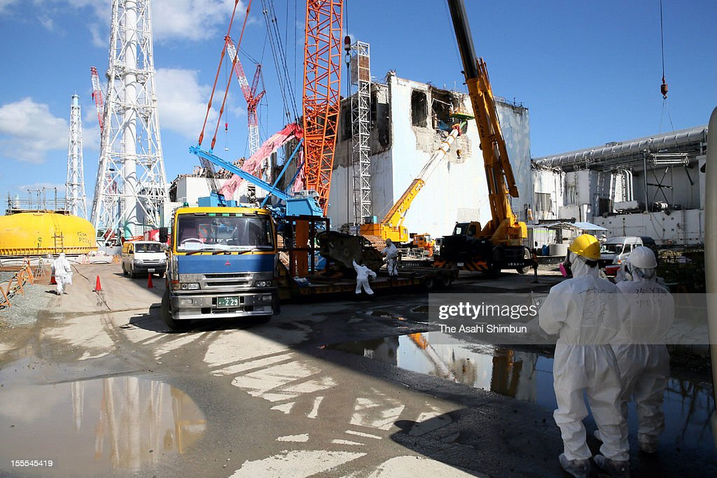 Workers continue decommissioning work at the fourth reactor building of the Fukushima Daiichi Nuclear Power Plant during the press tour on October 12, 2012 in Okuma, Fukushima, Japan.