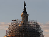 Workers continue repairs atop of the US Capitol dome that is covered in scaffoldingl November 4 2014 in Washington DC Today Americans will head to...