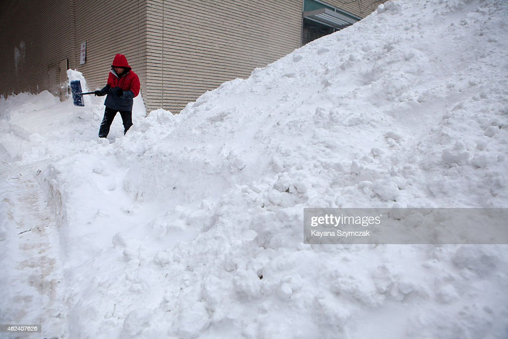 Workers continue snow removal efforts in the Back Bay neighborhood the day after Winter Storm Juno on January 28 2015 in Boston Massachusetts The...