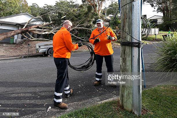 Workers continue the clean up effort in North Avoca on April 24 2015 in Gosford Australia Gosford City and Wyong shire have official been declared...
