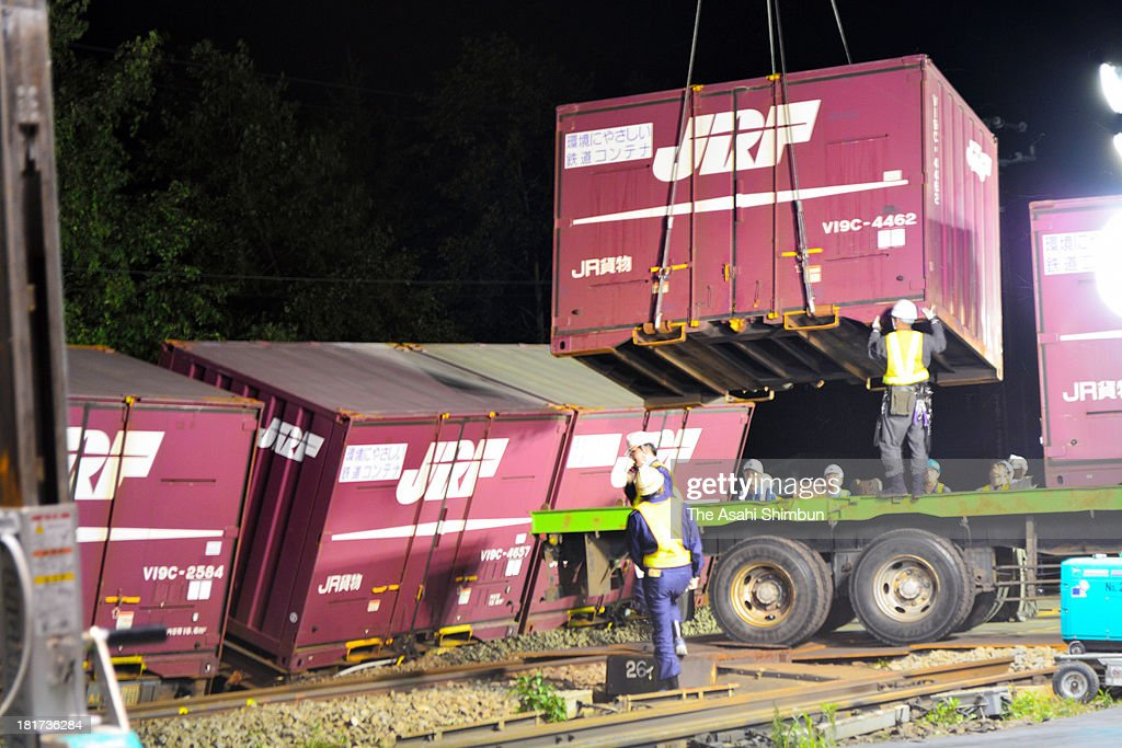 Workers continue the restoration as the container train derailed on September 20, 2013 in Nanae, Hokkaido, Japan. JR Hokkaido, long known for its poor safety record, said it found wider-than-standard gauges and other irregular rail conditions left unrectified at 97 locations, after one such case may have resulted in the derailment of a cargo train on September 19.