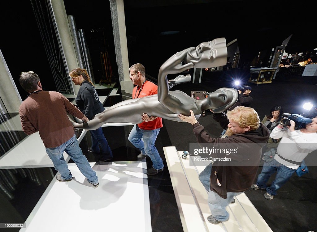 Workers continue to build the stage and the ballroom during the 19th Annual Screen Actor Guild Awards ceremony behind the scenes event at The Shrine Auditorium on January 25, 2013 in Los Angeles, California.