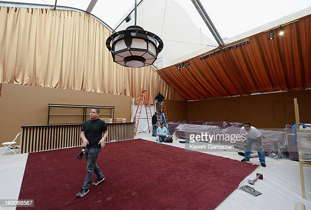 Workers continue to build the tent for the 19th Annual Screen Actor Guild Awards after party during behind the scenes event at The Shrine Auditorium...