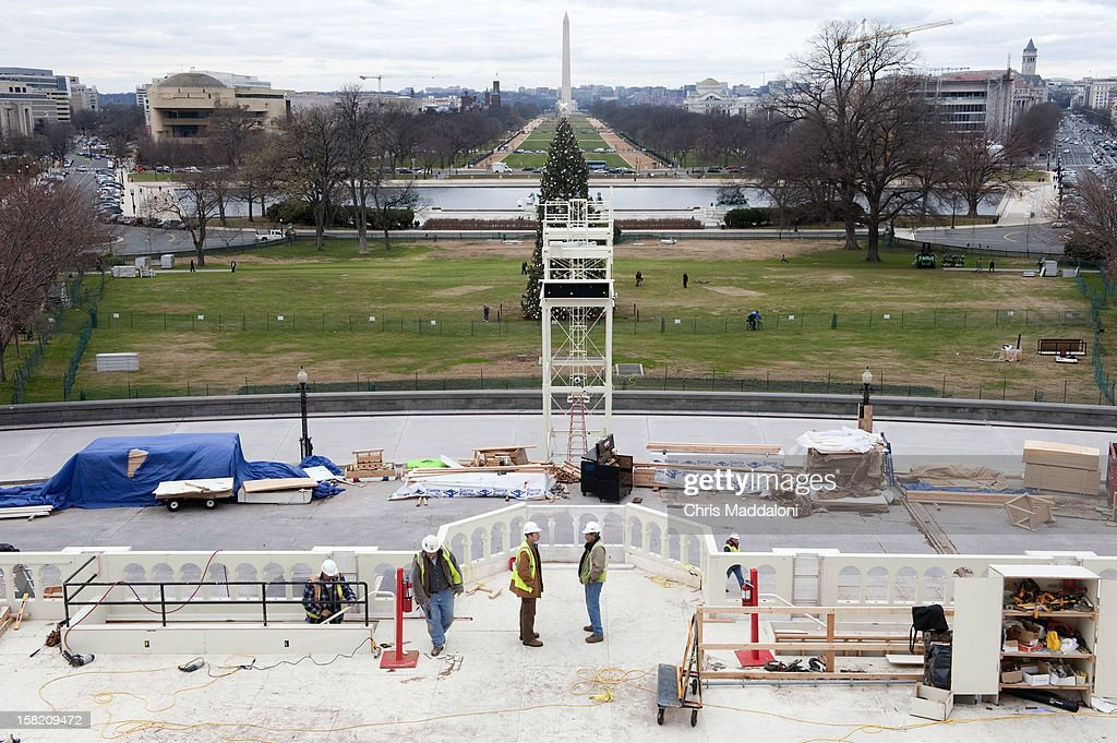 Workers continue to put on the finishing touches of the stands at the U.S. Capitol for President Barack Obama's Inauguration on January 21, 2013.