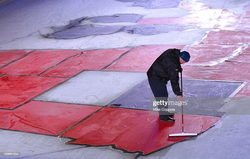 Workers cover a state on the ice at The Rink at Rockefeller Center during the results of the 2012 Presidential election on November 6, 2012 in New York City.