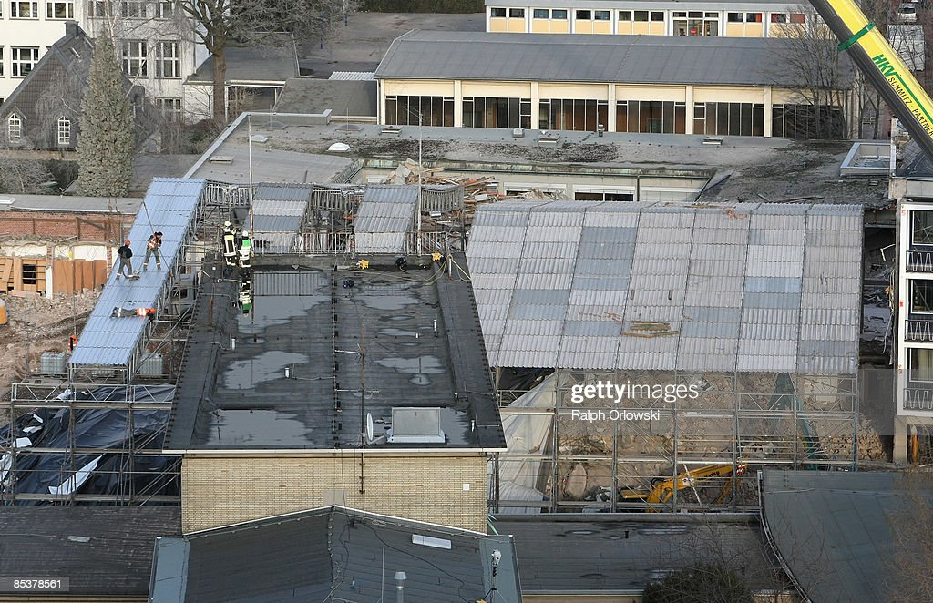 Workers cover the site of the collapsed Historical Archive of the City of Cologn will provisional roofs on March 11, 2009 in Cologne, Germany. Cologne's six-story city archive building collapsed on Tuesday, March 3.The archive building dragged down parts of two adjacent buildings that contained apartments and an amusement arcade. Cologne holds archive material going back over centuries, including manuscripts by communist pioneers Karl Marx and Friedrich Engels and documents related to German writer Heinrich Boell.