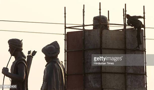 Workers covering the grand statue of Bahujan Samaj Party Chief Mayawati at Dalit Prerna Sthal on January 10 2012 in Noida India India's Election...