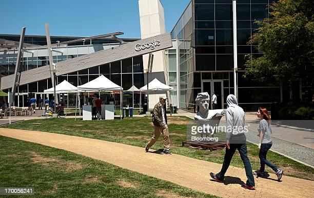 Workers cross a quad at Google Inc's headquarters before the company's annual shareholders meeting in Mountain View California US on Thursday June 6...
