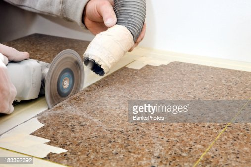 Workers Cutting Sink Hole In A Granite Countertop Stock