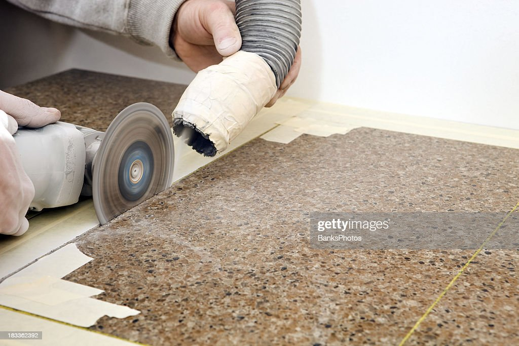 Good Workers Cutting Sink Hole In A Granite Countertop Stock Photo