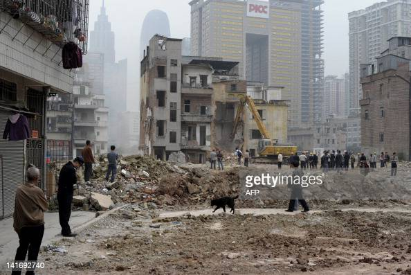 Workers demolish a group of villagers' houses in Yangji village in Guangzhou south China's Guangdong province on March 21 2012 Yangji is a former...