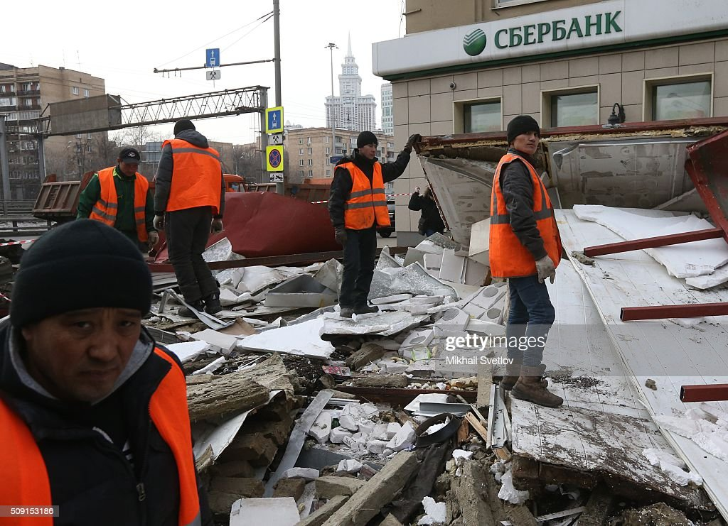 Workers demolish a private trade pavilion in the center on February 9, 2016 in Moscow, Russia. New Moscow authorities have ordered 97 shopping centers, trade pavilions, street kiosks and stalls built without legal documentation near metro stations to be removed, stating they may harm transport infrastructure engineering communications. Large-scale demolition of kiosks and small shopping centers began on Monday night with 55 percent of the properties having been completely removed by Tuesday morning.