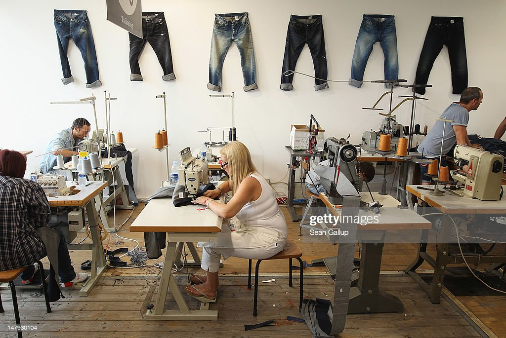 Workers demonstrate denim creation at the Laboratorio stand at the 2012 Bread & Butter fashion trade fair at former Tempelhof Airport on July 6, 2012 in Berlin, Germany. Bread & Butter is the world's largest trade fair for street fashion.