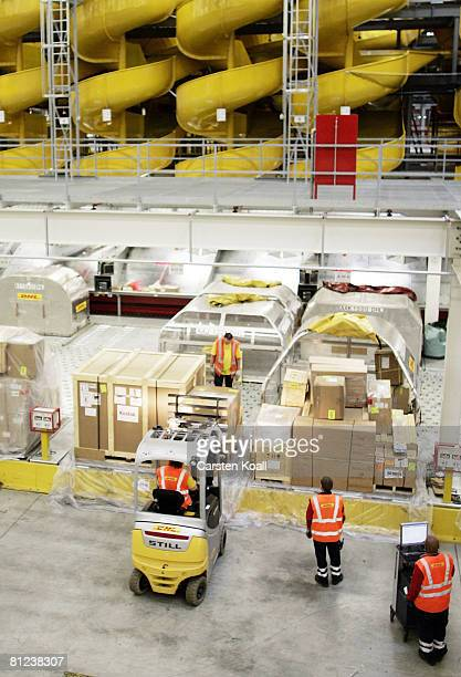 Workers demonstrate the workprocess in the new hall of the aviation hub at the airport LeipzigHalle on May 26 2008 in Leipzig Germany DHL Express...