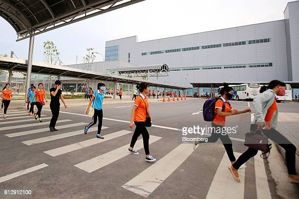 Workers depart the Samsung Electronics Vietnam Co Plant after finishing their shift at Yen Phong Industrial Park in Bac Ninh Province Vietnam on...