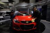 Workers detail a Chevrolet SS Sedan displayed at the General Motors headquarters April 1 2014 in Detroit Michigan General Motors has recalled...