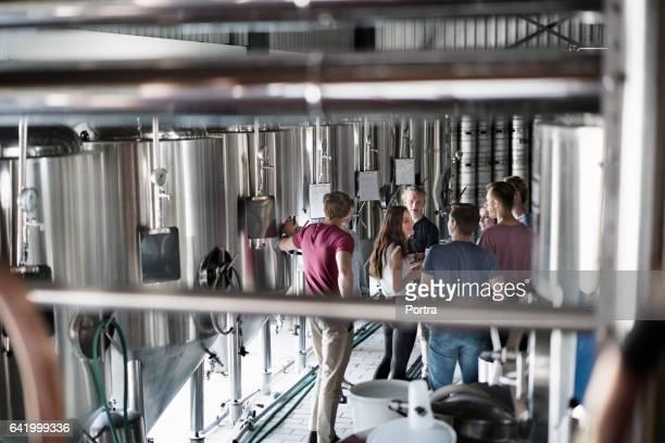 Workers discussing in beer industry