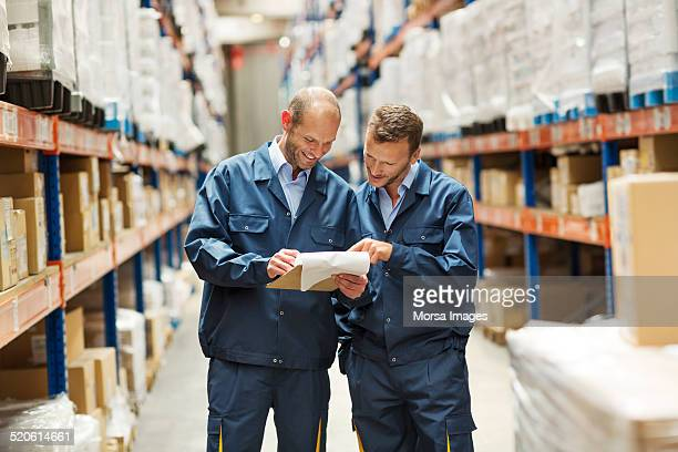 Workers discussing in warehouse