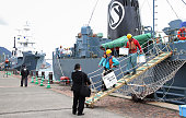 Workers disembark from a whaling ship at the port of Shimonoseki in western Japan on March 24 2016 A Japanese whaling fleet returned to its home port...