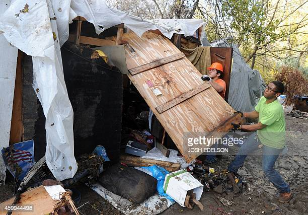 Workers dismantle a dwelling at a Silicon Valley homeless encampment known as The Jungle on December 4 in San Jose California Authorities began...