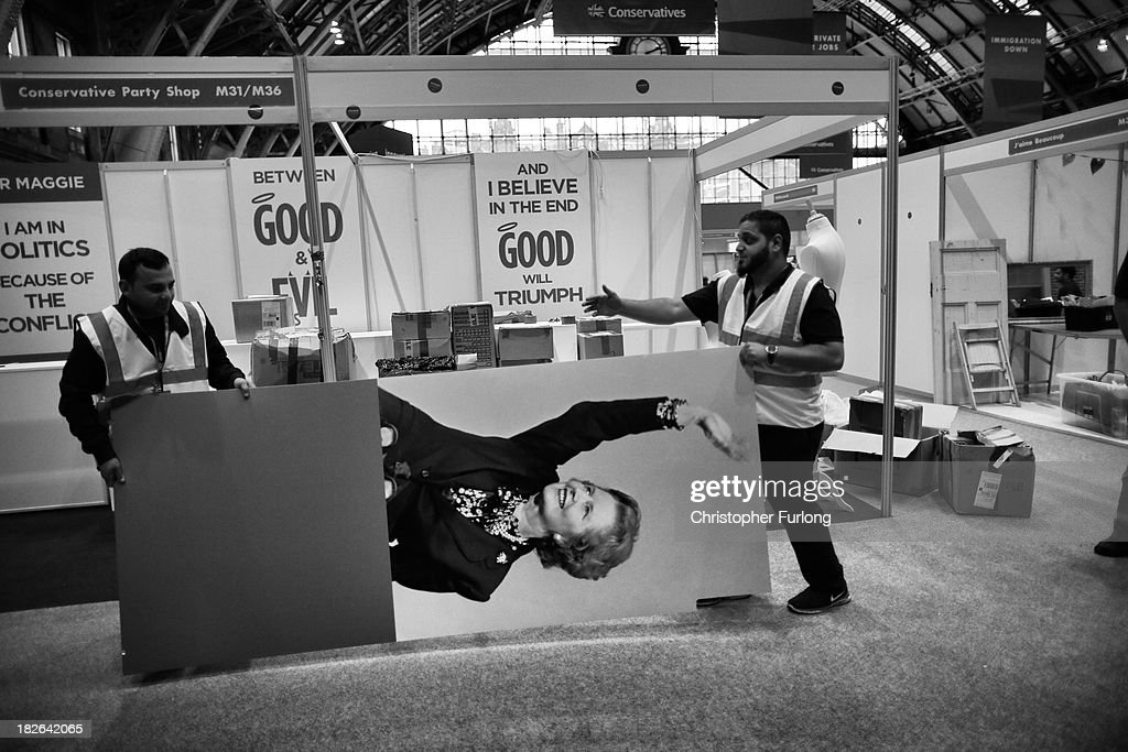 Workers dismantle Maggie's Shop and take away giant photographs of former Prime Minister Margaret Thatcher at the end of the annual Conservative Party Conference at Manchester Central on October 2, 2013 in Manchester, England. The shop has been popular with tory delegates selling out of many Thatcher themed items. Some of them, such as Maggie's handbag, are selling for three times their value on Ebay.