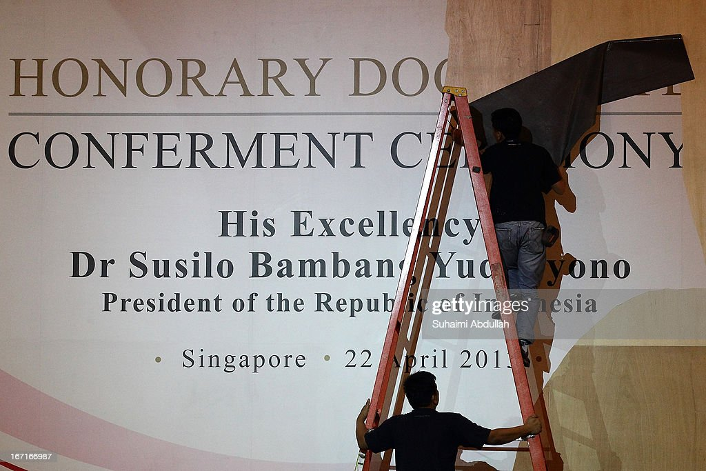 Workers dismantle the stage after the conclusion of the President of the Republic of Indonesia, Dr Susilo Bambang Yudhoyono honorary doctorate conferment ceremony on April 22, 2013 in Singapore. It is reported that President Susilo Bambang Yudhoyono will hold a Leaders' Retreat with Singapore Prime Minister Lee Hsien Loong as part of the visit.