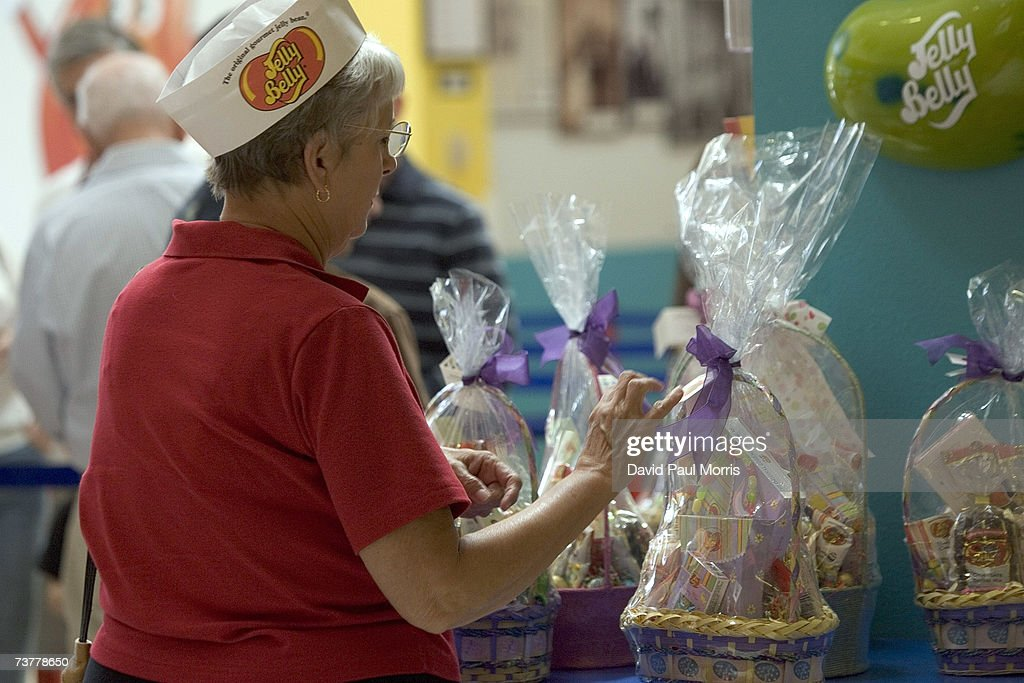Workers display Easter baskets at the Jelly Belly Factory April 2, 2007 in Fairfield, California. The Jelly Belly Factory produces approximately 14 billion jelly beans a year. With less than a week before Easter Sunday, retailers stock their shelves full of jelly beans, chocolates, and other traditional candies for Easter.