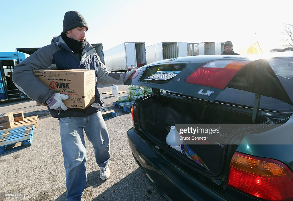 Workers distribute essential goods to residents at a site maintained by the Town of Hempstead in cooperation with FEMA at Oceanside Park during in the aftermath of Superstorm Sandy on November 9, 2012 in Merrick, New York. New York Gov. Andrew M. Cuomo has said that the economic loss and damage to homes and businesses caused by Sandy could total $33 billion in New York, according to published reports.