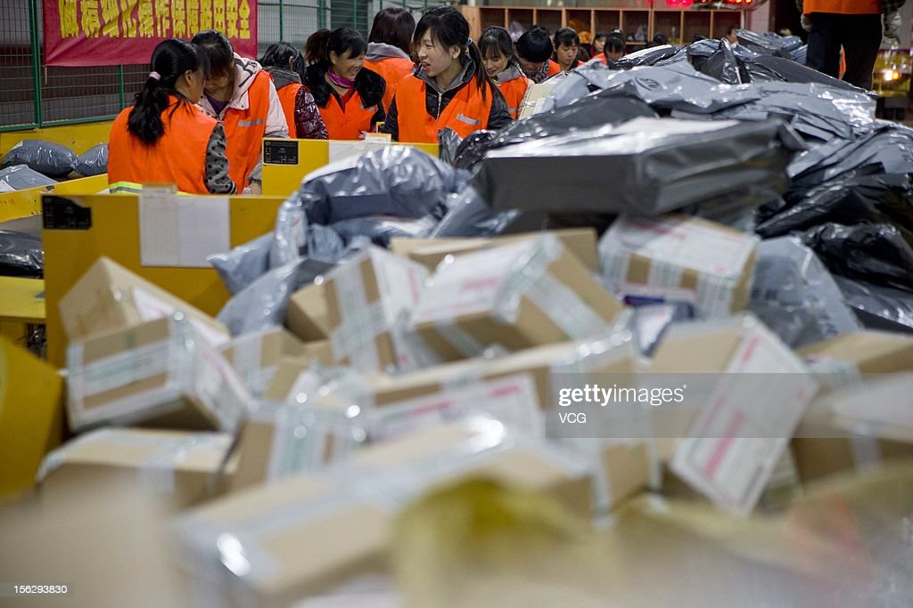 Workers distribute packs at an express company on November 11, 2012 in Hangzhou, China. Tmall.com and Taobao.com, the China's biggest online shopping sites of Chinese e-commerce giant Alibaba Group Holding, had 19.1 billion yuan (3.04 billion U.S. dollars) in total transactions during its 'Singles' Day' shopping promotion on Sunday. And 'Singles' Day', which has become a shopping festival of e-business groups, caused enormous pressure on express service.
