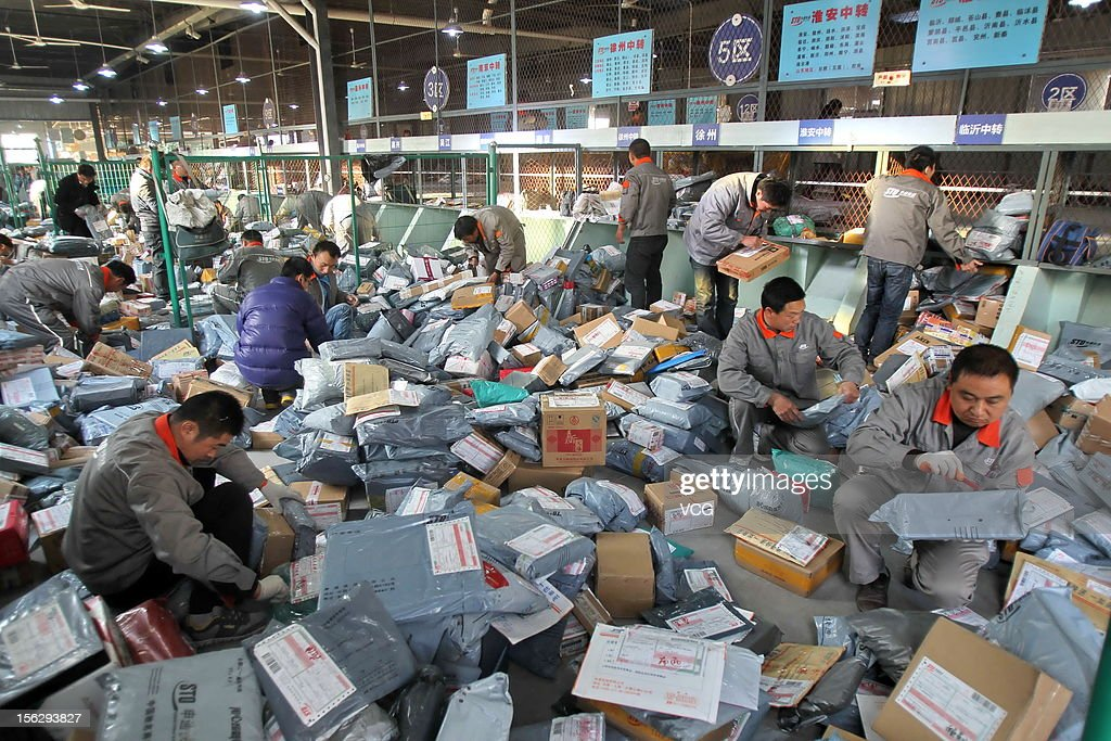 Workers distribute packs at an express company on November 12, 2012 in Nantong, China. Tmall.com and Taobao.com, the China's biggest online shopping sites of Chinese e-commerce giant Alibaba Group Holding, had 19.1 billion yuan (3.04 billion U.S. dollars) in total transactions during its 'Singles' Day' shopping promotion on Sunday. And 'Singles' Day', which has become a shopping festival of e-business groups, caused enormous pressure on express service.