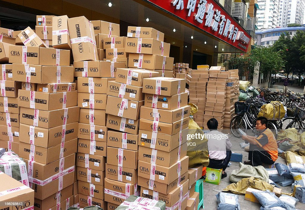 Workers distribute packs at an express company on November 12, 2012 in Guangzhou, China. Tmall.com and Taobao.com, the China's biggest online shopping sites of Chinese e-commerce giant Alibaba Group Holding, had 19.1 billion yuan (3.04 billion U.S. dollars) in total transactions during its 'Singles' Day' shopping promotion on Sunday. And 'Singles' Day', which has become a shopping festival of e-business groups, caused enormous pressure on express service.