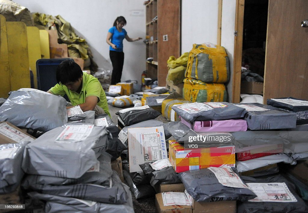 Workers distribute packs at an express company on November 12, 2012 in Qionghai, China. Tmall.com and Taobao.com, the China's biggest online shopping sites of Chinese e-commerce giant Alibaba Group Holding, had 19.1 billion yuan (3.04 billion U.S. dollars) in total transactions during its 'Singles' Day' shopping promotion on Sunday. And 'Singles' Day', which has become a shopping festival of e-business groups, caused enormous pressure on express service.