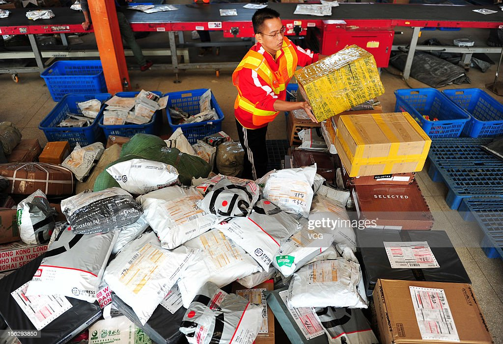 Workers distribute packs at an express company on November 12, 2012 in Nanchang, China. Tmall.com and Taobao.com, the China's biggest online shopping sites of Chinese e-commerce giant Alibaba Group Holding, had 19.1 billion yuan (3.04 billion U.S. dollars) in total transactions during its 'Singles' Day' shopping promotion on Sunday. And 'Singles' Day', which has become a shopping festival of e-business groups, caused enormous pressure on express service.