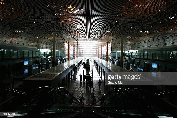 Workers do preparation in the new terminal building T3 at the Beijing Capital International Airport on February 28 2008 in Beijing China T3...