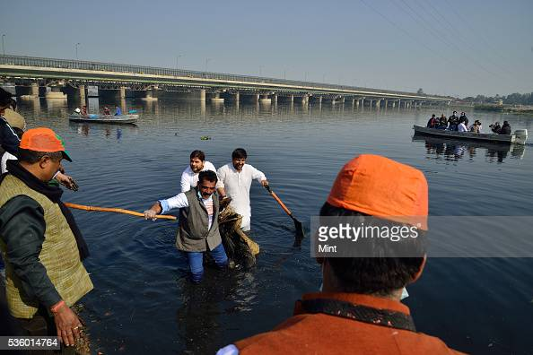 BJP workers doing Shramdaan at ITO Chhath Ghat on the birthday of former PM Atal Bihari Vajpayee on December 25 2015 in New Delhi India